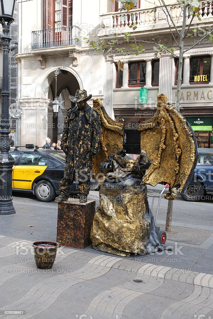 Demon and Man Living Statues royalty-free stock photo