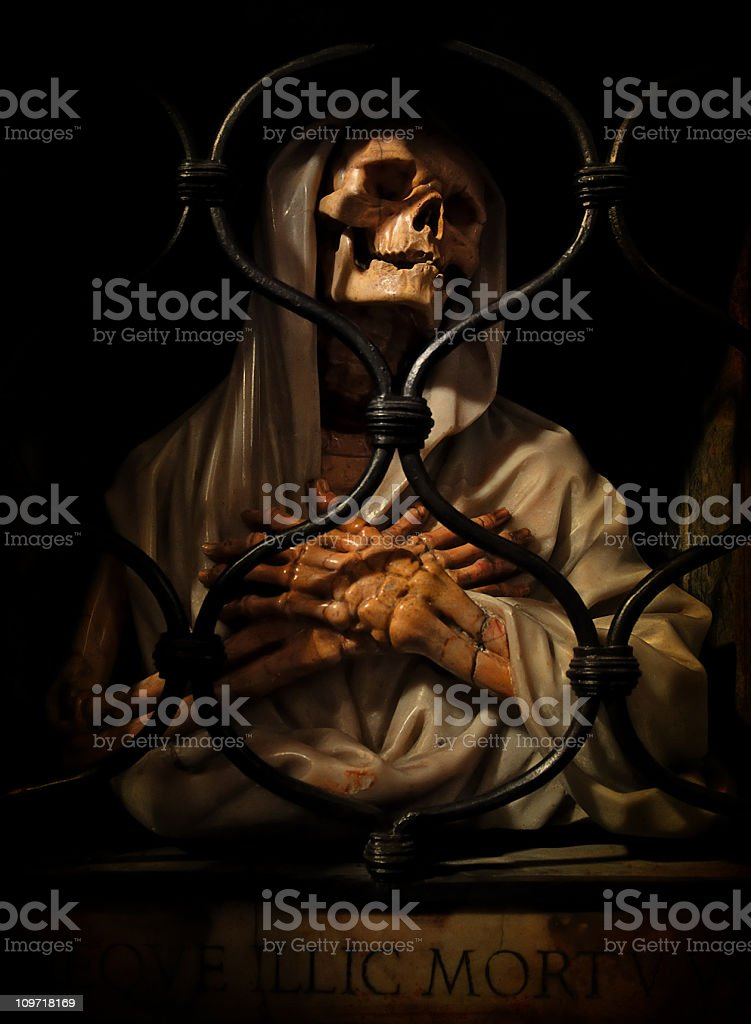 demon behind bars stock photo