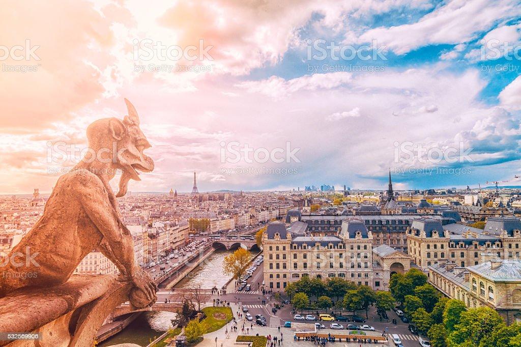 Demon gargoyle and Paris Cityscape from Notre Dame stock photo