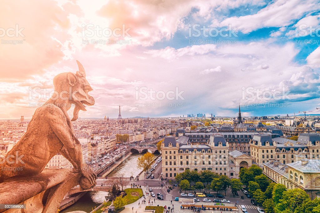 Demon gargoyle and Paris Cityscape from Notre Dame stock photo
