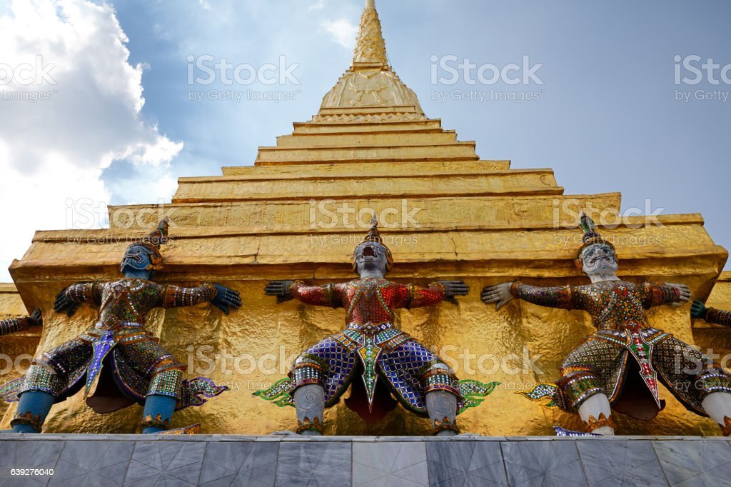 Demon Guardian statues at Emerald Buddha temple in Bangkok stock photo