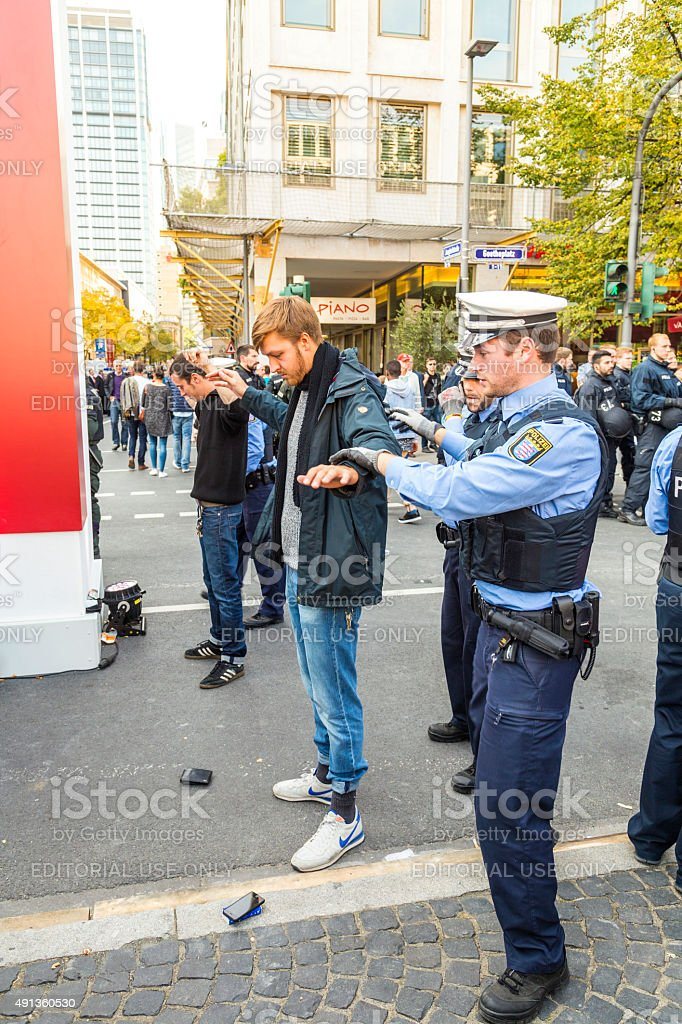 demonstrant is checked by police at   anniversary of German Unity stock photo
