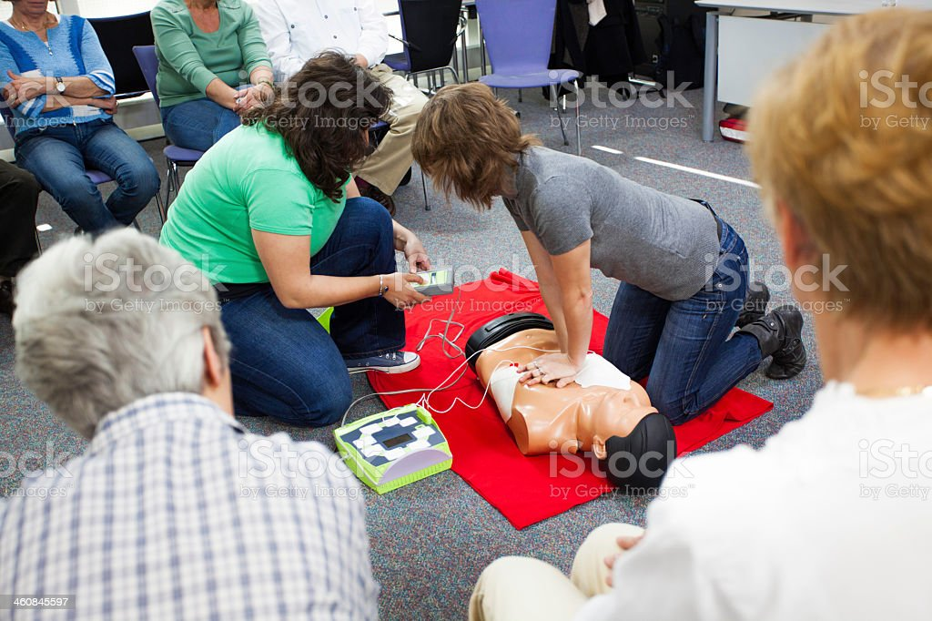 Demonstrating Chest Compressions stock photo