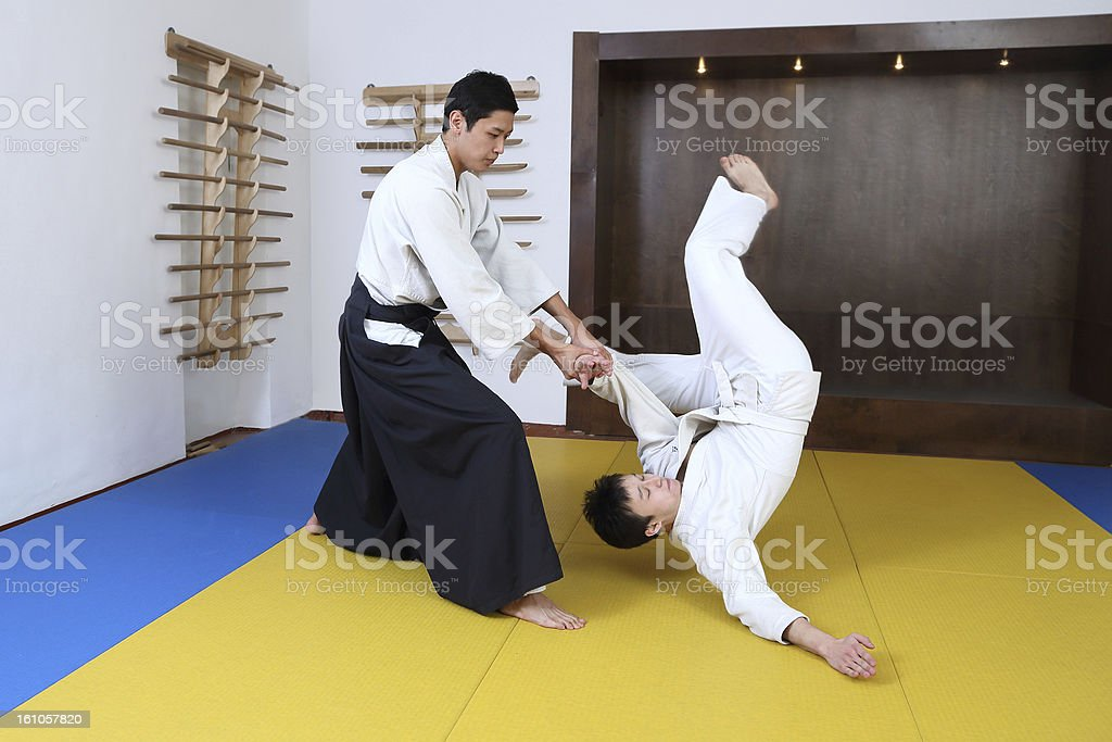 Demonstration of fighting art Aikido. stock photo