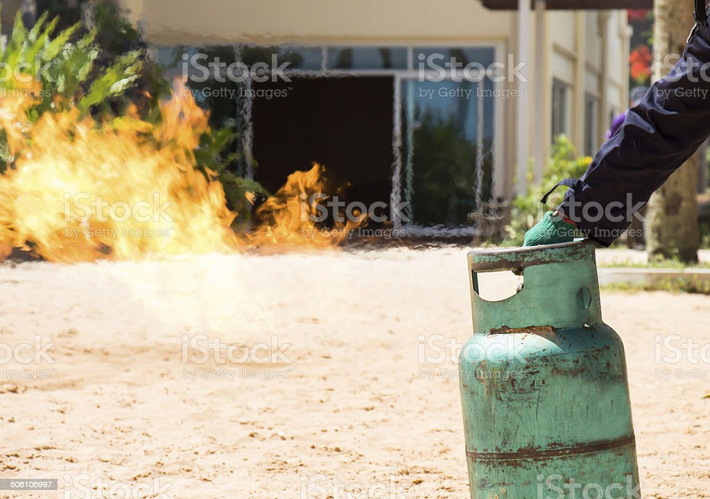Demonstration of fire caused by gas canisters by hand stock photo
