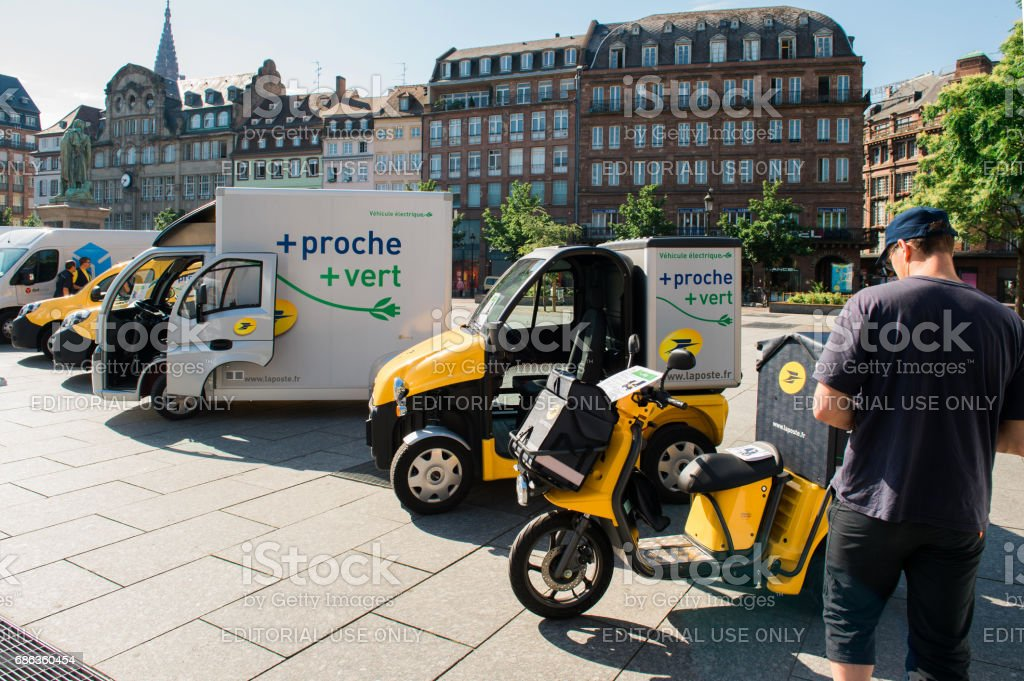 Demonstration of postal electric vehicles in city center France stock photo