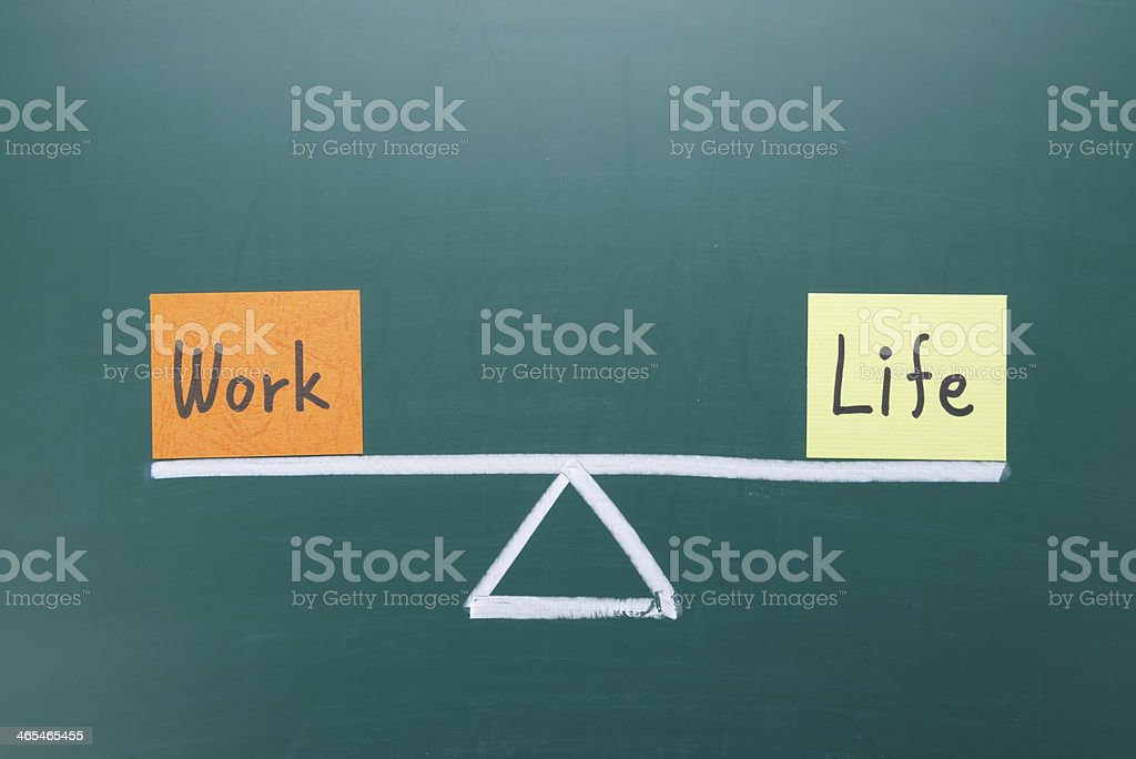 Demonstration of work and life balance on a scale royalty-free stock photo