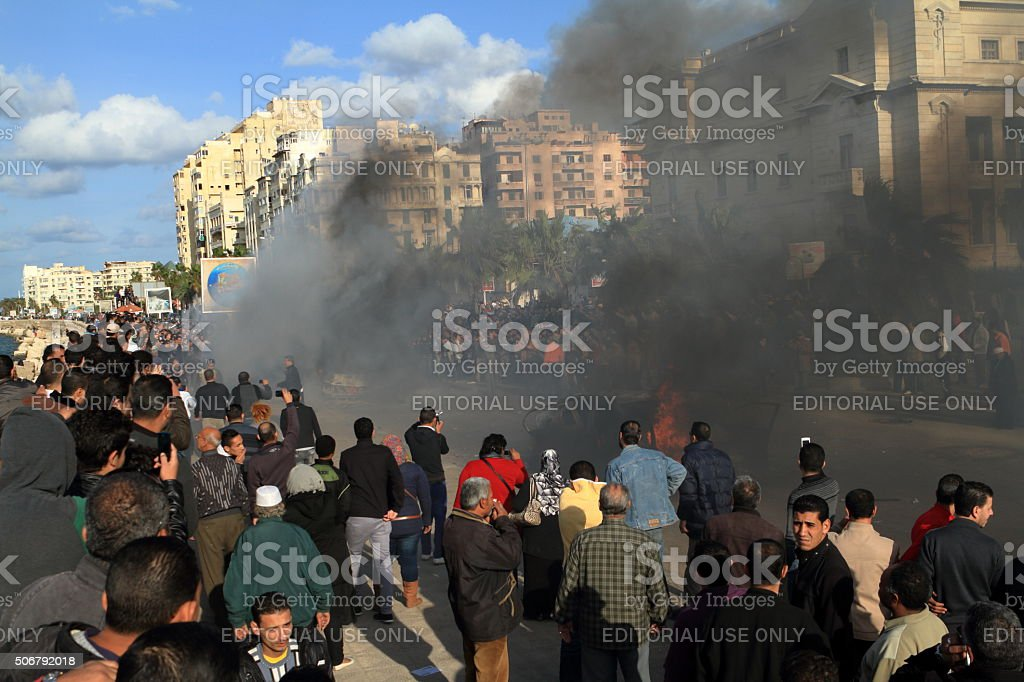 Demonstrations and burning cars in Alexandria Egypt stock photo