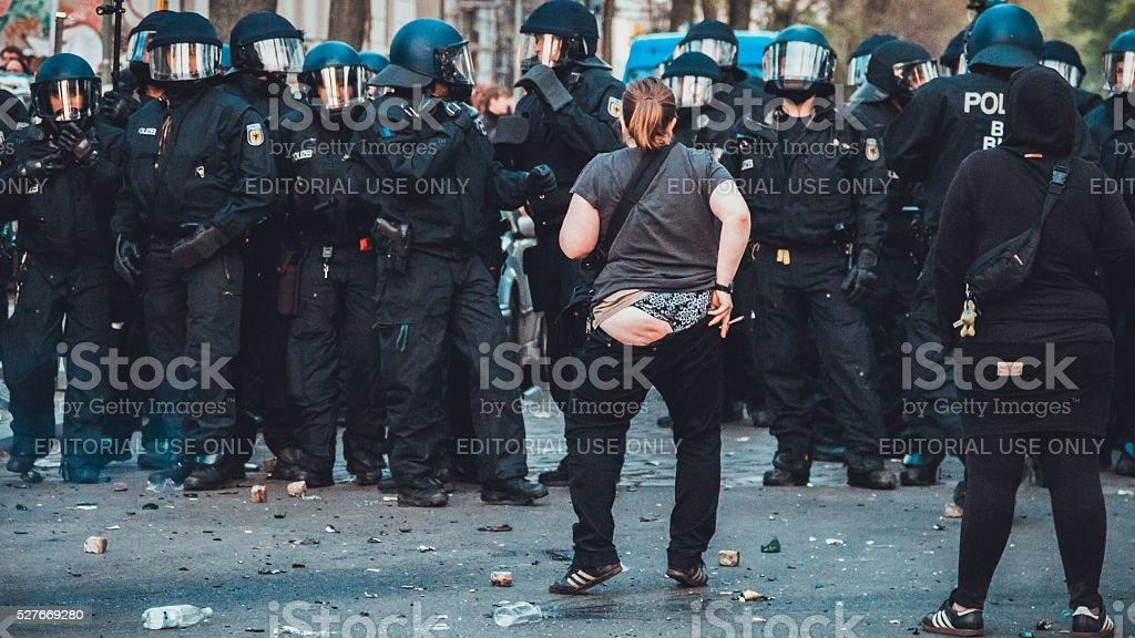 Demonstrator against police stock photo