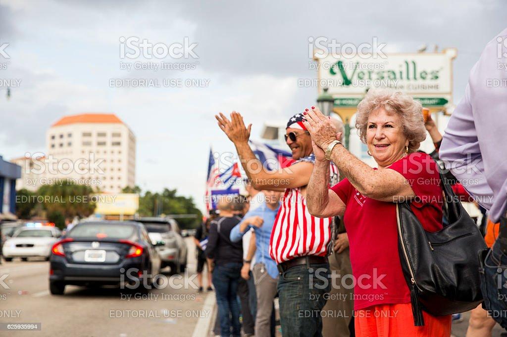 Demonstrators celebrate the death of Fidel Castro stock photo