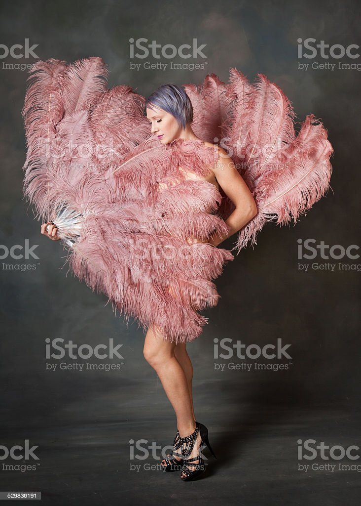 Demure burlesque dancer stock photo