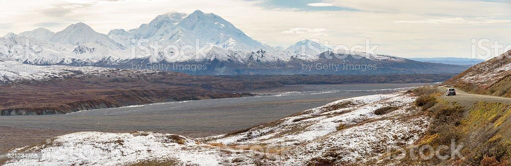 Denali Mountain and Alaska Range Panorama with Car on Road stock photo