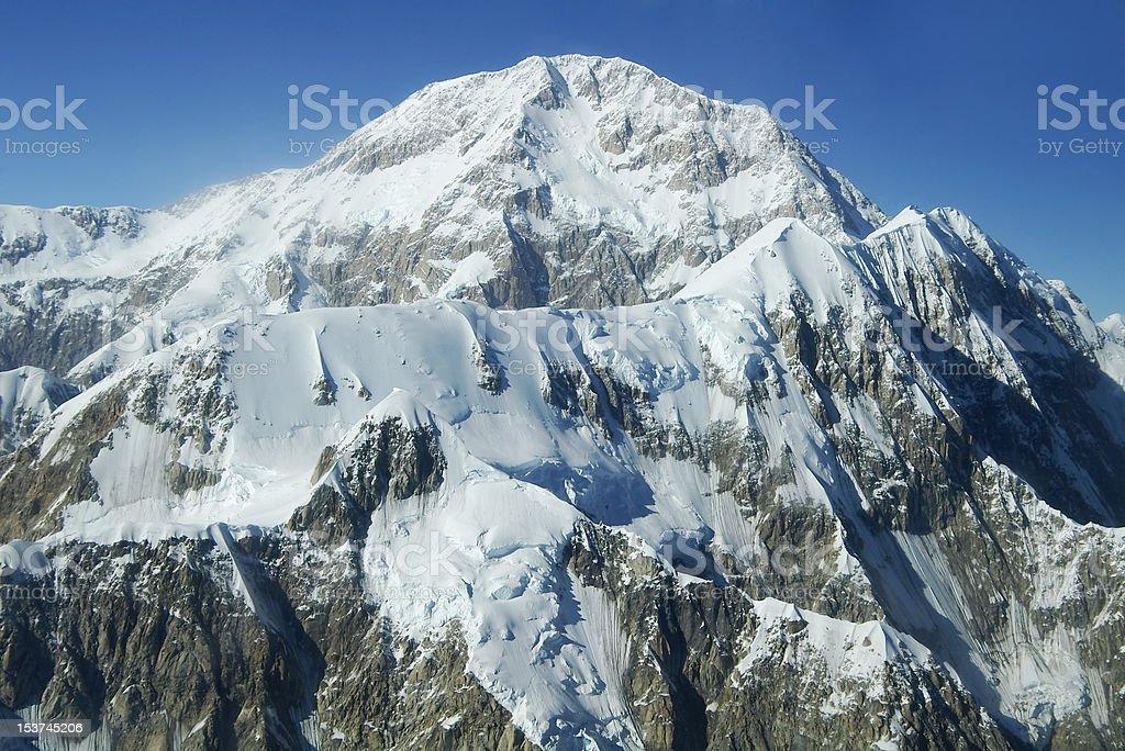 Denali Peaks Under Blue Sky stock photo