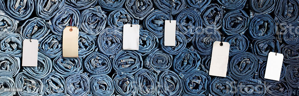 denim background with labels stock photo