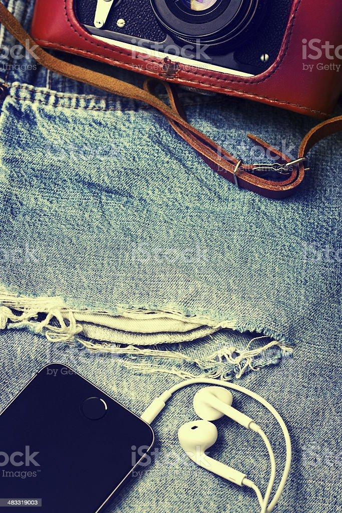 Denim background with smartphone,  camera stock photo