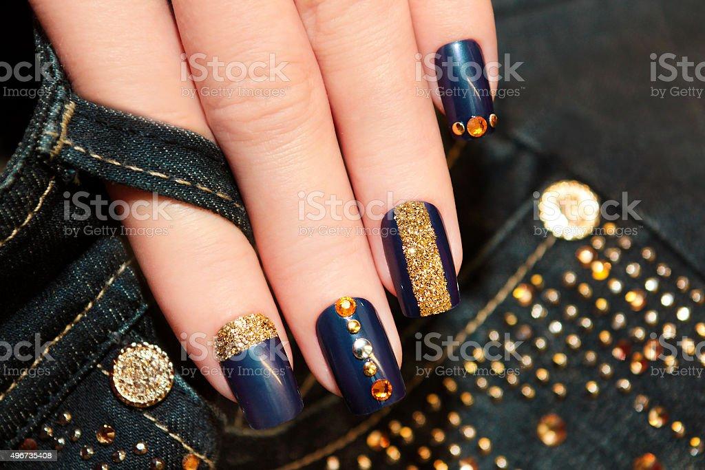 Denim blue manicure. stock photo