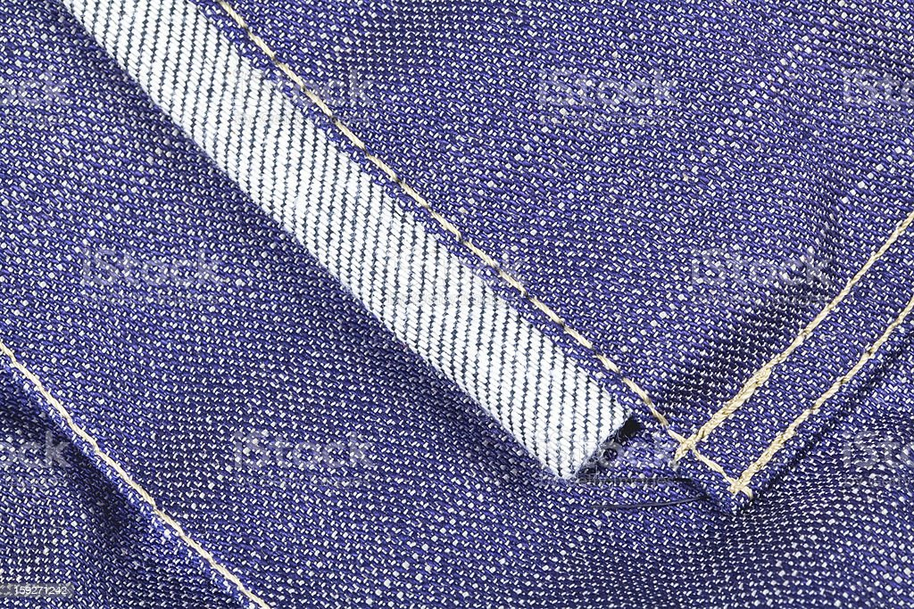 Denim fabric texture with seams royalty-free stock photo