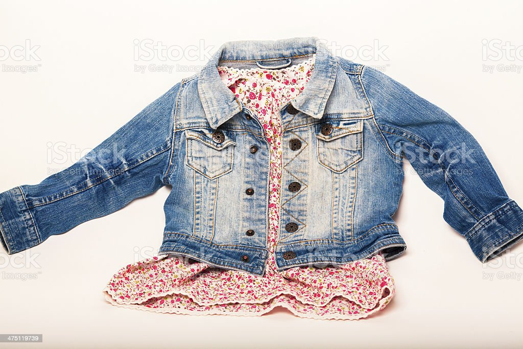 denim jacket combined with a beautiful red dress stock photo