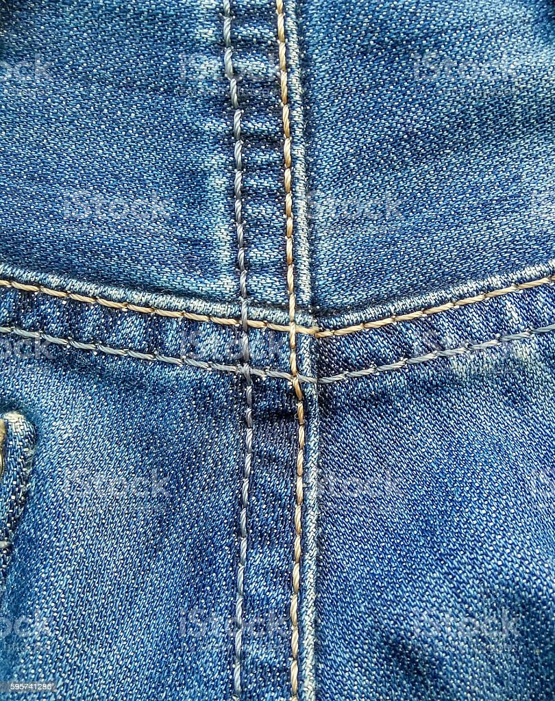 Denim jeans background with seams stock photo