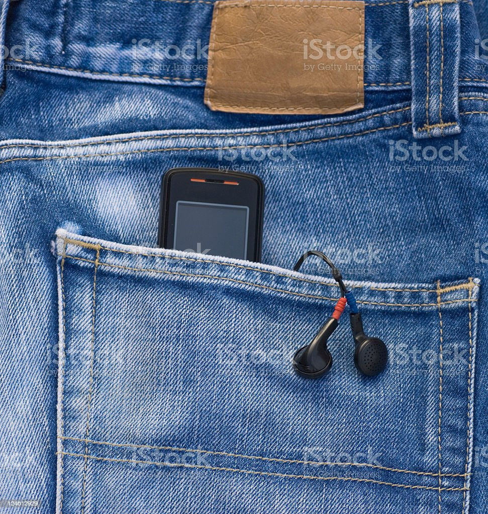 Denim Pocket with Cell Phone royalty-free stock photo