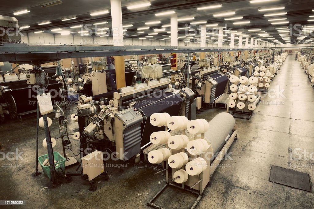 Denim Textile Industry - Weaving Jeans Fabric on Airjet Looms stock photo