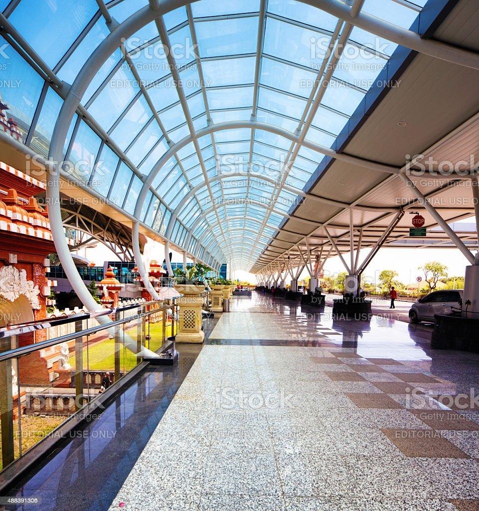 Denpasar airport departure drop off outdoors glass canopy stock photo