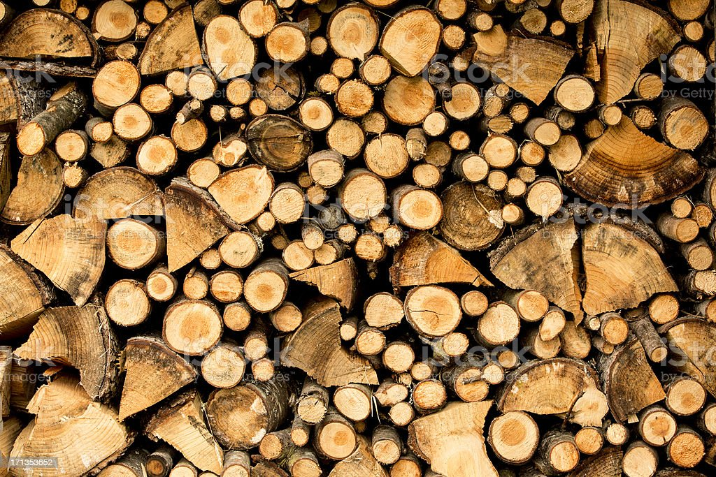 Densely stacked wood stock photo