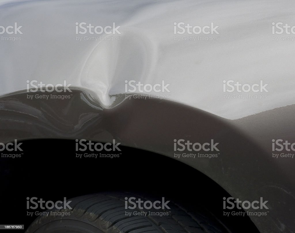 Dent in a car's body from an auto accident  stock photo