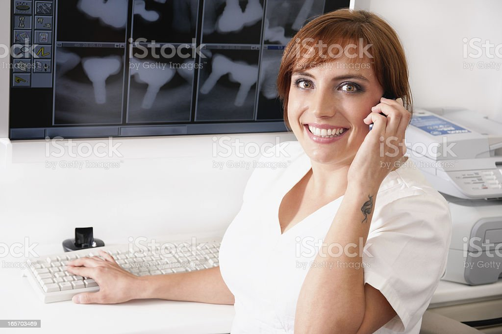 Dental assistant on a phone royalty-free stock photo