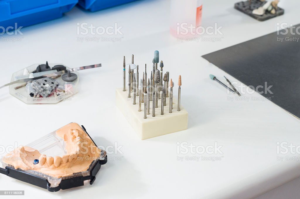 Dental burs and dental articulator in a lab. stock photo
