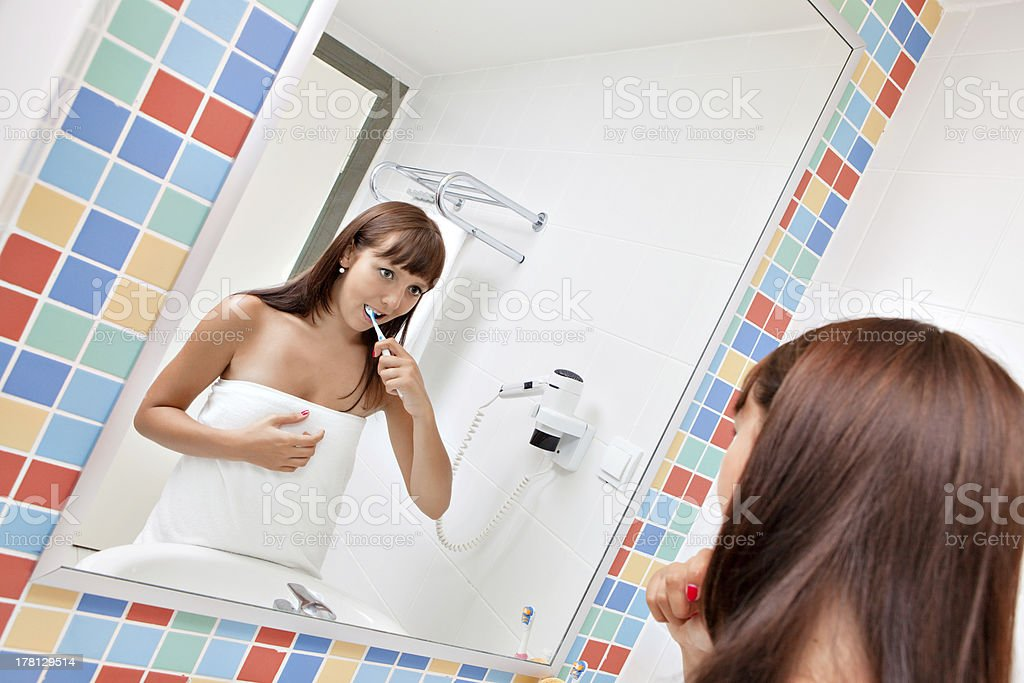 Dental care.Woman cleans a teeth royalty-free stock photo