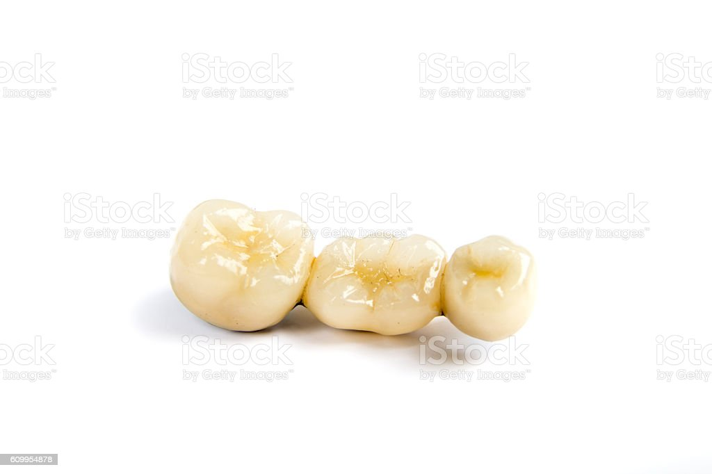 Dental ceramic tooth crowns on white background. Isolated. stock photo