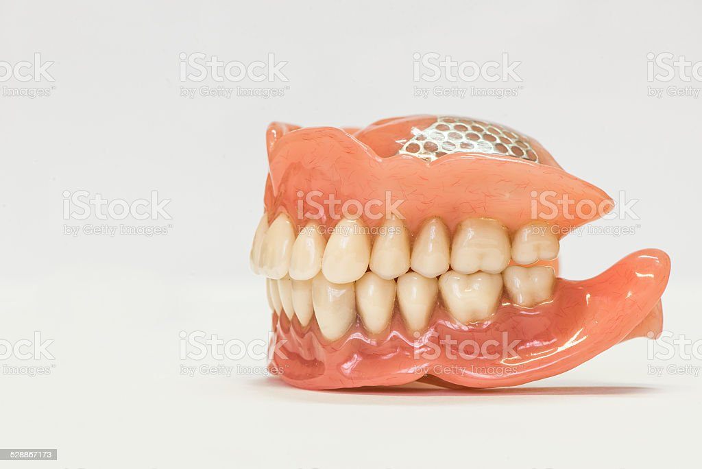 Dental dentures isolated on white stock photo