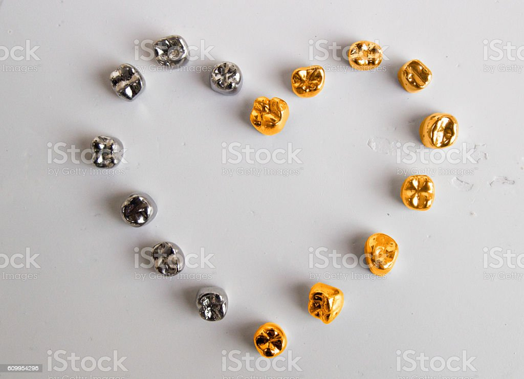 Dental  gold and metal tooth crowns. Isolated. stock photo
