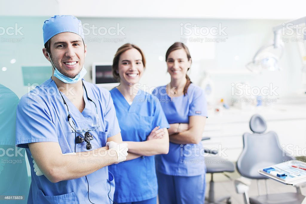 Dental health assistant and patient. stock photo
