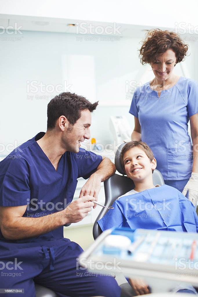 Dental heath doctor chatting with young patient. royalty-free stock photo