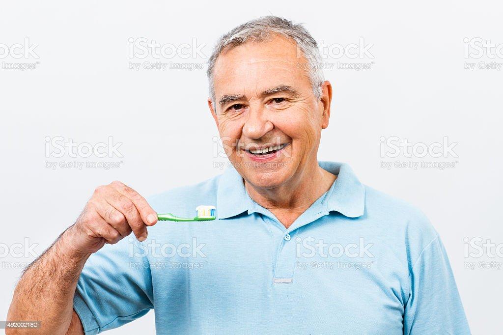 Dental hygiene for senior man stock photo