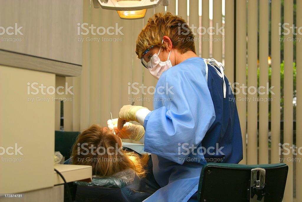 Dental Hygienist Cleans Teeth royalty-free stock photo