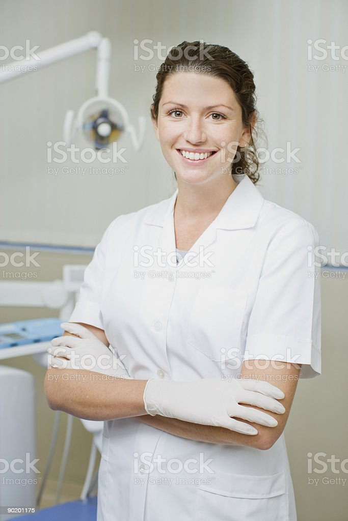 Dental hygienist standing in dentists examination room stock photo