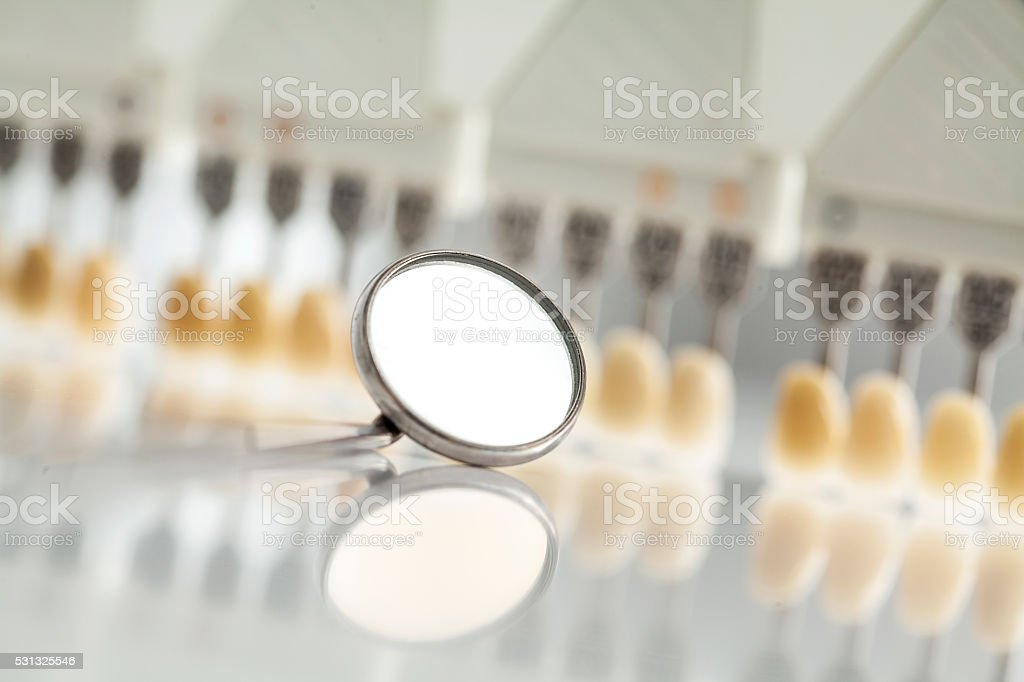 Dental mirror and color shades stock photo