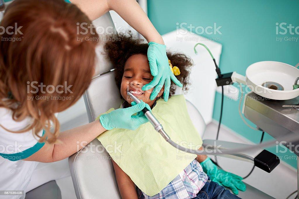 Dental polishing treatment in dental clinic stock photo