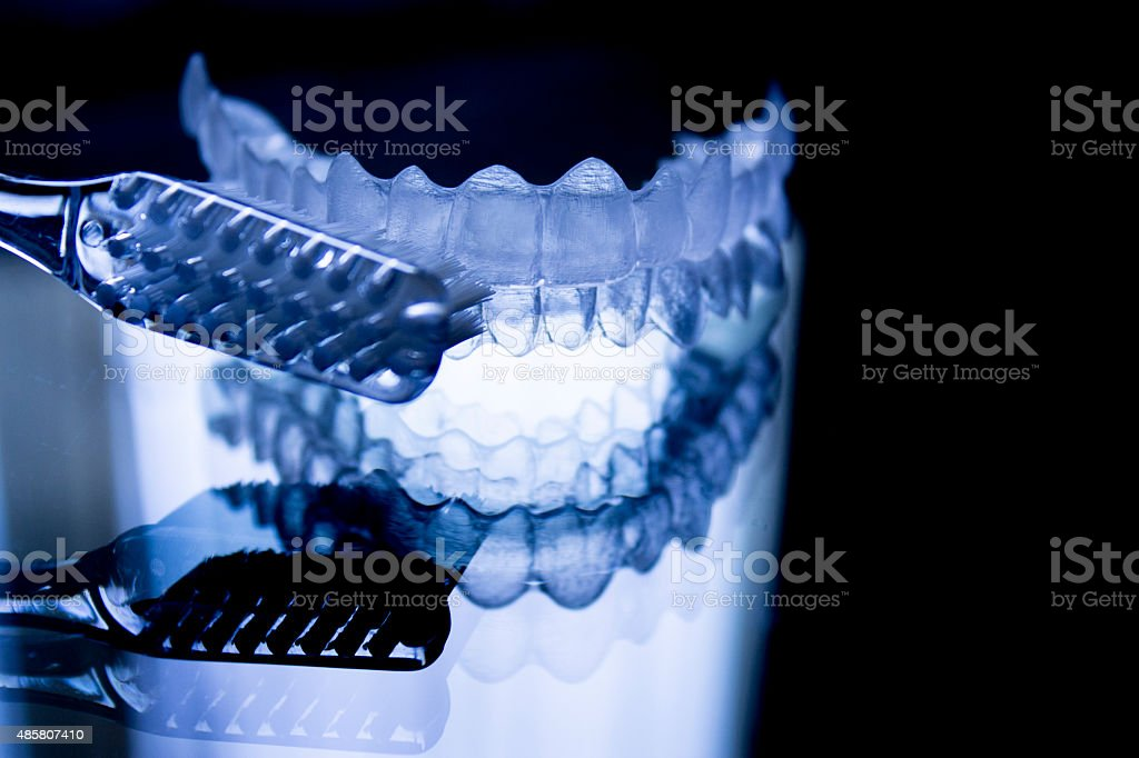 Dental retainers and toothbrush stock photo