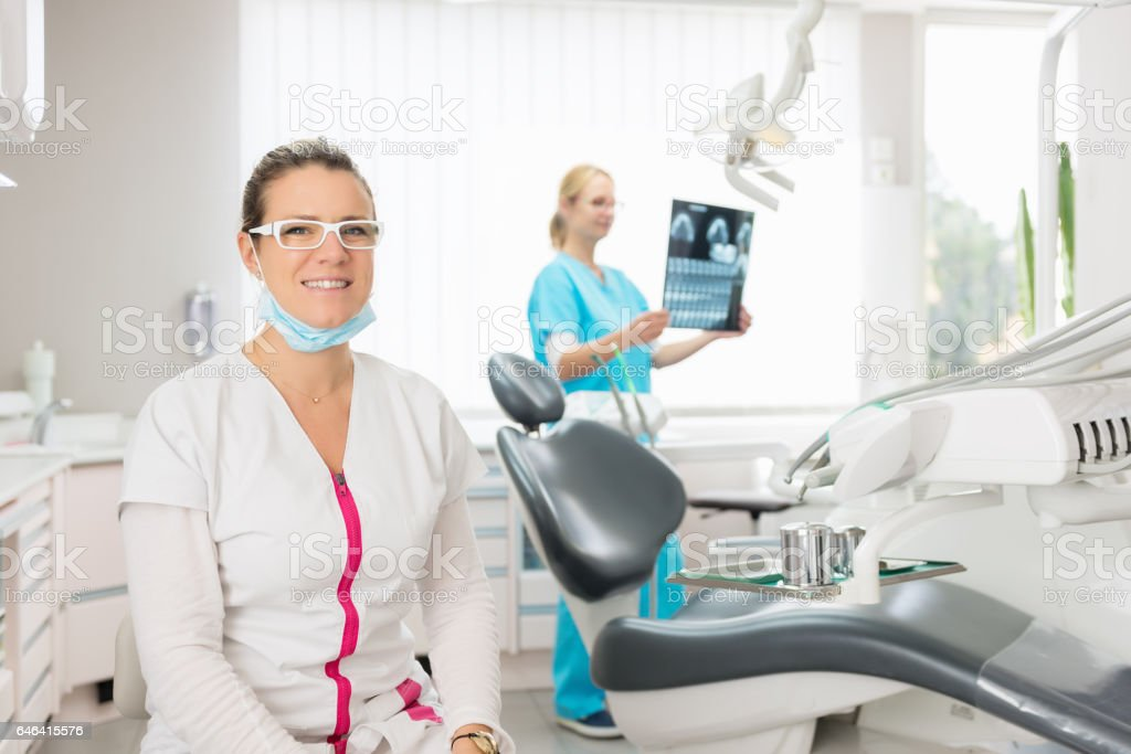 Dental team at dentist office stock photo
