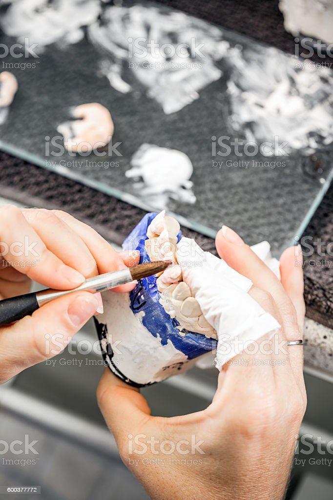Dental technician paint stock photo