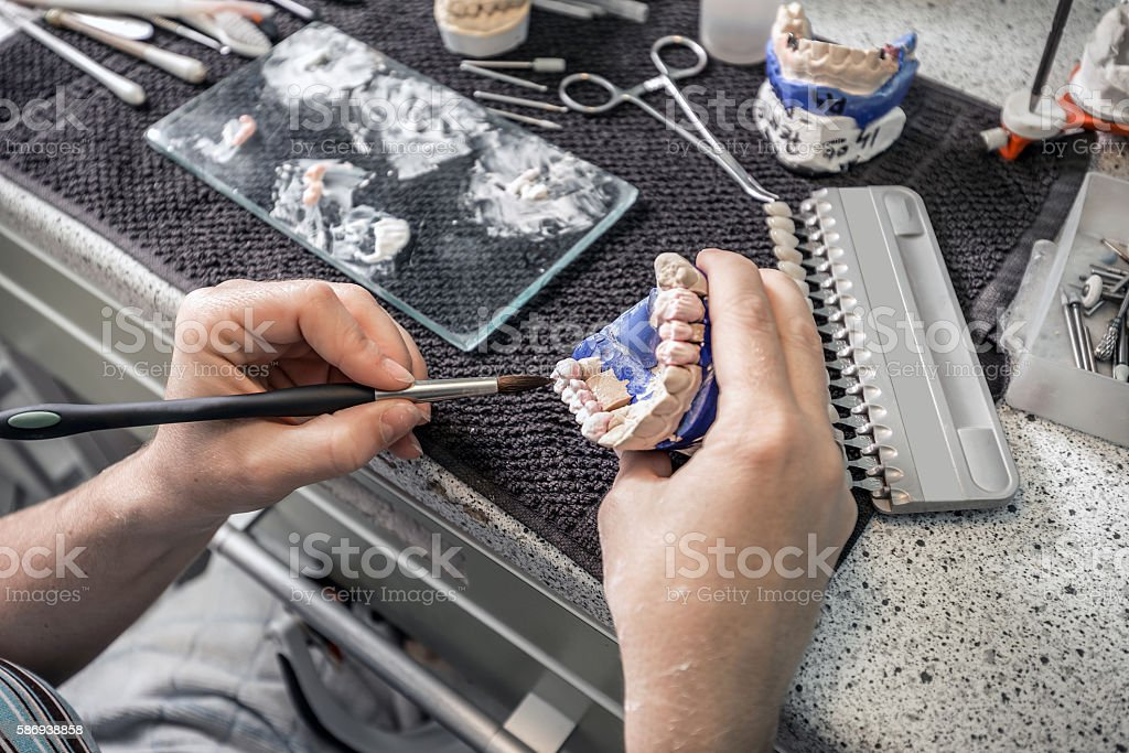 Dental technician working stock photo
