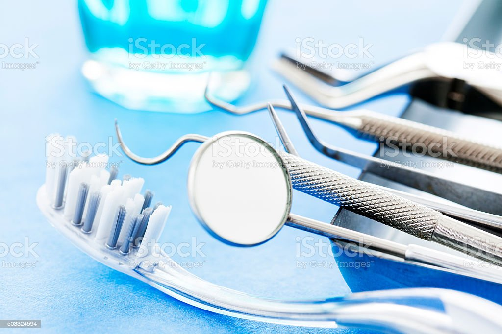 Dental tools and toothbrush stock photo