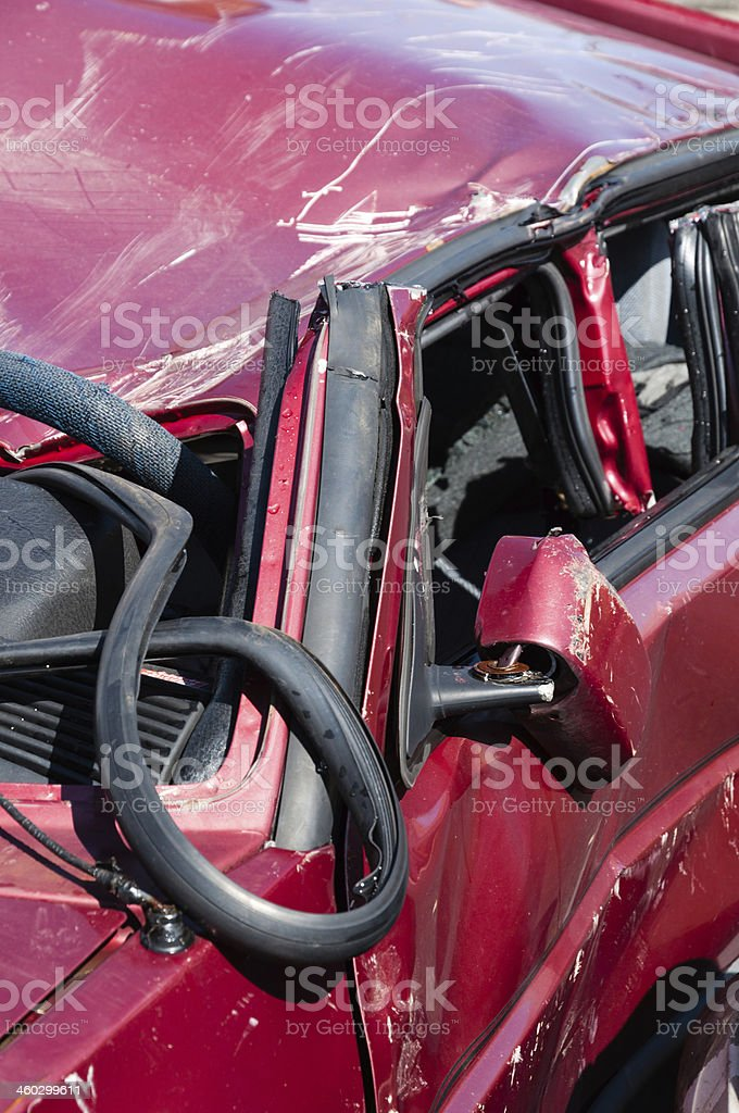 Dented car for a firefighters show exercise stock photo