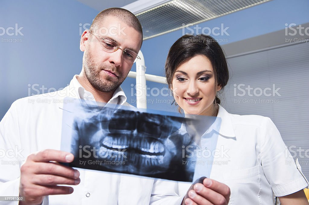 Dentist and assistant checking x-ray stock photo