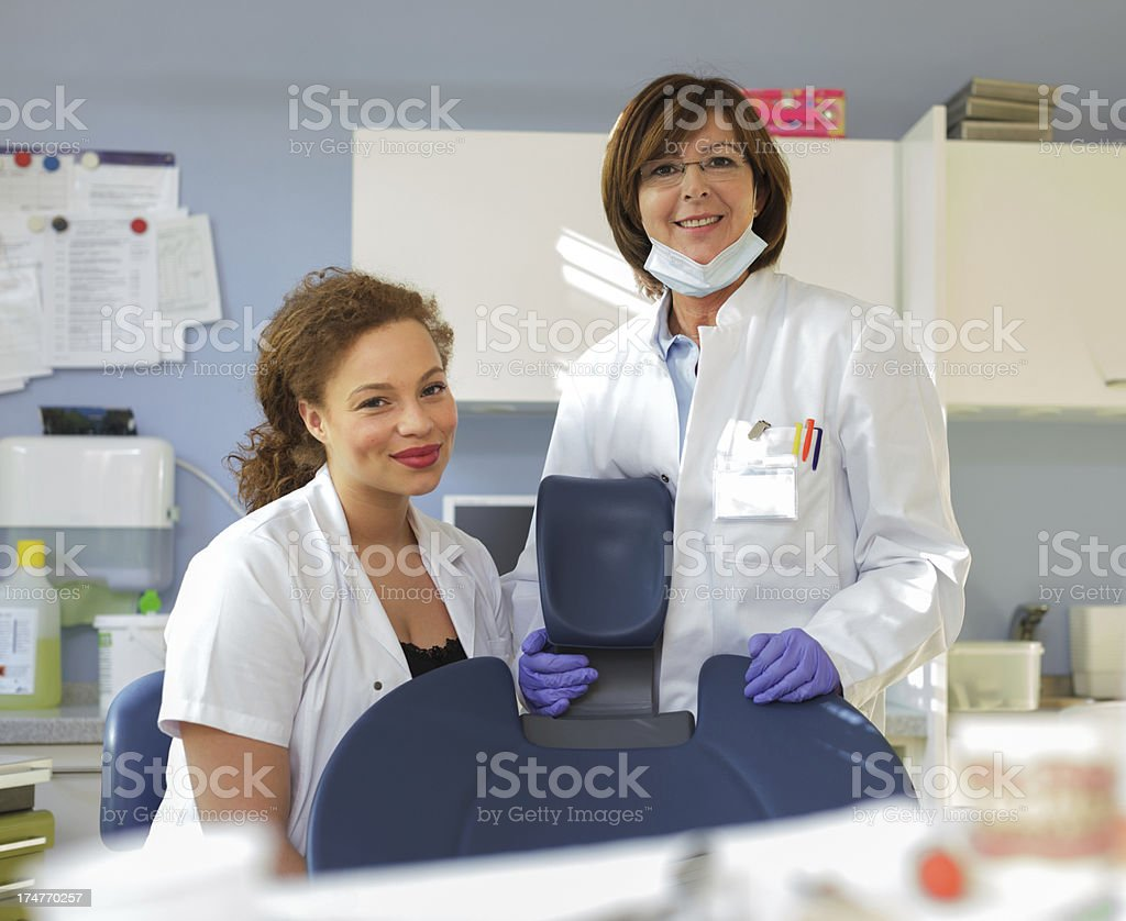 Dentist and Assistant stock photo