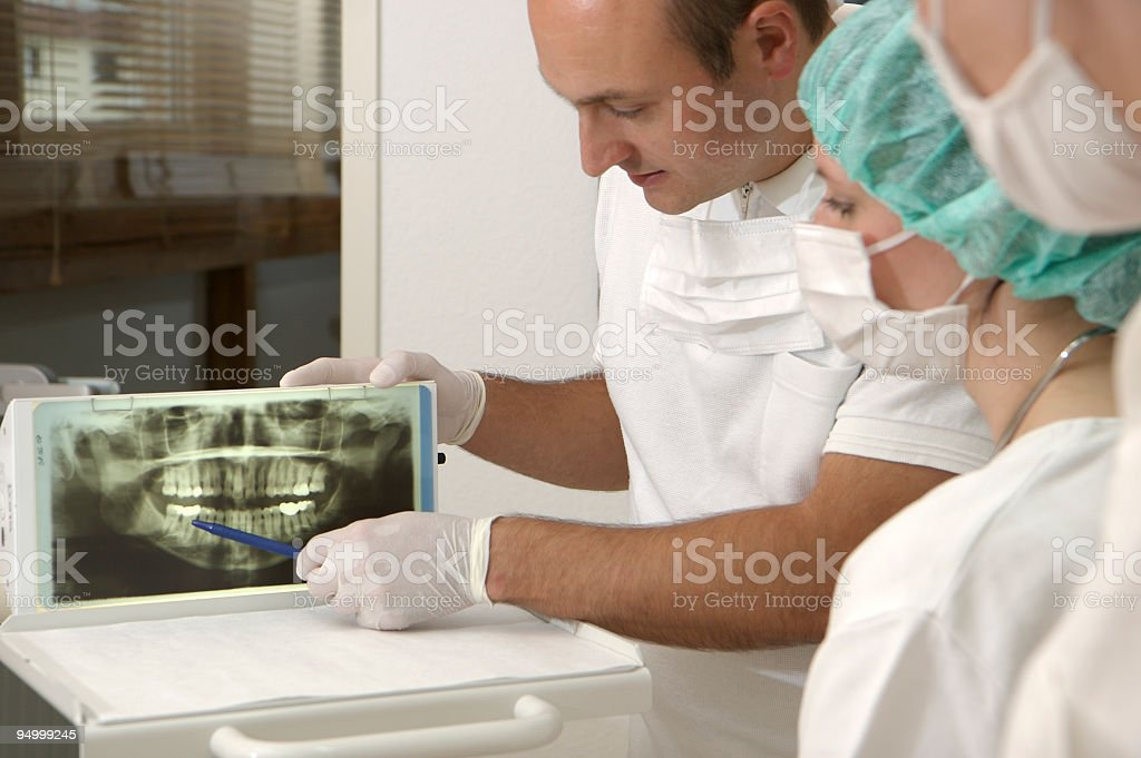 dentist and assistants making an expertise about a x-ray image royalty-free stock photo